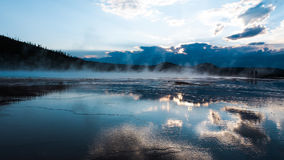 Grand Prismatic Spring, Yellowstone. Sunset over Grand Prismatic Spring, midway geyser Yellowstone national park Royalty Free Stock Image