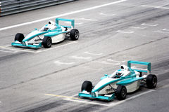 Grand Prix. Racing cars at starting grid Royalty Free Stock Photos