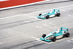 Grand Prix. Racing cars at starting grid Royalty Free Stock Image