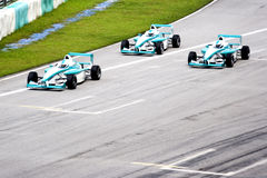 Grand Prix. Racing cars in action Stock Images