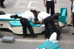 Grand Prix Car Repair. Stalled grand prix car being repaired at the starting grid Stock Images