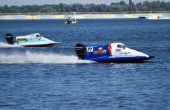 Grand Prix Formula 1 H2O World Championship. VYSHGOROD, UKRAINE - JULY 20 : Powerboat number 77 GC Team F1 fast speed ,pilot Matt Paljreyman . Grand Prix Formula Stock Image