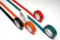 Grand Prix. Some rolls of colored insulating tape on a white surface stock photo