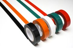 Grand Prix. Some rolls of colored insulating tape on a white surface royalty free stock photography
