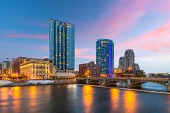 Grand Rapids, Michigan, USA Downtown Skyline. On the Grand River at dusk royalty free stock image
