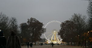 Grand Roue seen from Tuileries Gardens in Paris during new year illuminations. PARIS, FRANCE - CIRCA 2015: Grand Roue seen from Tuileries Gardens in Paris during stock video