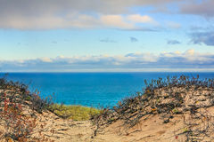 Grand Sable Dunes and Lake Superior. The light of early morning illumines the landscape of Grand Sable Dunes and Lake Superior at Upper Peninsula Michigan's stock photos