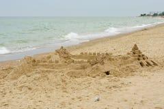 Grand sand castle on an empty beach Stock Photos