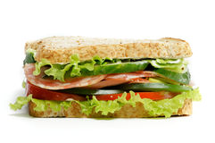 Grand Sandwich. Grand  Sandwich with ham, lettuce, cucumber, tomato and salad isolated on white background Royalty Free Stock Photo