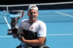 Grand Slam champion Dylan Alcott of Australia during trophy presentation after 2019 Australian Open quad wheelchair singles final. MELBOURNE, AUSTRALIA - JANUARY stock photos