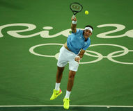 Grand Slam Champion Juan Martin Del Porto of Argentina in action during men`s singles first round match of the Rio 2016 Olympics. RIO DE JANEIRO, BRAZIL - AUGUST Royalty Free Stock Images