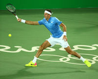 Grand Slam Champion Juan Martin Del Porto of Argentina in action during men`s singles first round match of the Rio 2016 Olympics Stock Photo