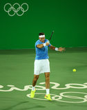 Grand Slam Champion Juan Martin Del Porto of Argentina in action during men`s singles first round match of the Rio 2016 Olympics Royalty Free Stock Photo