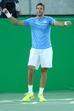 Grand Slam Champion Juan Martin Del Porto of Argentina celebrates victory after singles semifinal of the Rio 2016 Olympic Games Stock Photo