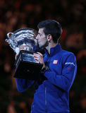 Grand Slam champion Novak Djokovic of Sebia holds Australian Open trophy during trophy presentation Stock Images