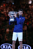 Grand Slam champion Novak Djokovic of Sebia holds Australian Open trophy during trophy presentation Royalty Free Stock Photos