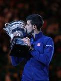 Grand Slam champion Novak Djokovic of Sebia holds Australian Open trophy during trophy presentation Stock Image
