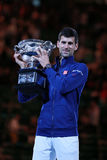 Grand Slam champion Novak Djokovic of Sebia holds Australian Open trophy during trophy presentation Royalty Free Stock Photography