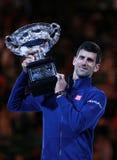 Grand Slam champion Novak Djokovic of Sebia holds Australian Open trophy during trophy presentation Royalty Free Stock Images