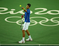 Grand Slam champion Novak Djokovic of Serbia in action during men`s singles first round match of the Rio 2016 Olympic Games Stock Photography