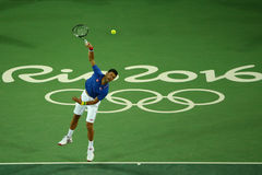 Grand Slam champion Novak Djokovic of Serbia in action during men`s singles first round match of the Rio 2016 Olympic Games Stock Photos