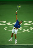 Grand Slam champion Novak Djokovic of Serbia in action during men`s singles first round match of the Rio 2016 Olympic Games Royalty Free Stock Photos