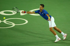 Grand Slam champion Novak Djokovic of Serbia in action during men`s singles first round match of the Rio 2016 Olympic Games Royalty Free Stock Image