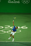 Grand Slam champion Novak Djokovic of Serbia in action during men`s singles first round match of the Rio 2016 Olympic Games Royalty Free Stock Images