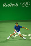 Grand Slam champion Novak Djokovic of Serbia in action during men`s singles first round match of the Rio 2016 Olympic Games Stock Image
