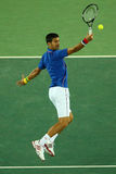 Grand Slam champion Novak Djokovic of Serbia in action during men`s singles first round match of the Rio 2016 Olympic Games Stock Images