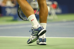 Grand Slam champion Novak Djokovic of Serbia wears custom Adidas tennis shoes during match at US Open 2016 Royalty Free Stock Image