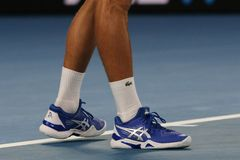 Grand Slam champion Novak Djokovic of Serbia wears custom Asis tennis shoes during his final match at 2019 Australian Open. MELBOURNE, AUSTRALIA - JANUARY 27 royalty free stock images