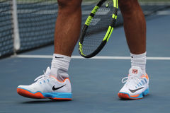 Grand Slam champion Rafael Nadal of Spain wears custom Nike tennis shoes during practice for US Open 2016. NEW YORK - SEPTEMBER 3, 2016: Grand Slam champion royalty free stock photos
