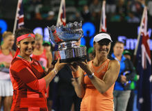 Grand Slam champion Sania Mirza of India and  Martina Hingis of Switzerland during trophy presentation after doubles final match Stock Photography
