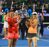 Grand Slam champion Sania Mirza of India and  Martina Hingis of Switzerland during trophy presentation after doubles final match Royalty Free Stock Photography