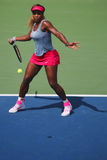 Grand Slam champion Serena Williams during quarterfinal doubles match at US Open 2014 Stock Image