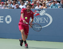 Grand Slam champion Stanislas Wawrinka of Switzerland in action during his round four match at US Open 2016 Royalty Free Stock Photo