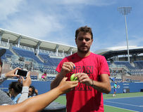 Grand Slam champion Stanislas Wawrinka of Switzerland signing autographs after practice for US Open Royalty Free Stock Photography
