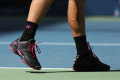 Grand Slam champion Stanislas Wawrinka of Switzerland wears custom Yonex tennis shoes during match at US Open 2016 Royalty Free Stock Photos