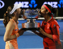 Grand Slam champions Martina Hingis of Switzerland and Sania Mirza of India  during trophy presentation after doubles final match Stock Photo
