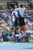Grand Slam champions Mike and Bob Bryan celebrating victory after semifinal doubles match at US Open 2014 Royalty Free Stock Images