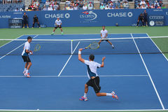 Grand Slam champions Mike and Bob Bryan (at the front) during US Open 2014 round 3 doubles match Stock Images