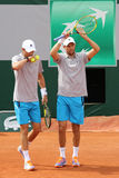 Grand Slam champions Mike and Bob Bryan of United States in action during second round match at Roland Garros 2015 Royalty Free Stock Photo