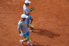 Grand Slam champions Mike and Bob Bryan of United States in action during second round match at Roland Garros Royalty Free Stock Photos