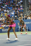 Grand Slam champions Serena Williams and Venus Williams during first round doubles match at US Open 2013 Stock Photos