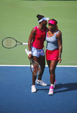 Grand Slam champions Serena Williams and Venus Williams during quarterfinal doubles match at US Open 2014 Royalty Free Stock Images
