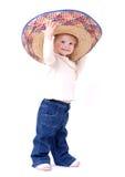 Grand sombrero sur l'enfant en bas âge photographie stock libre de droits