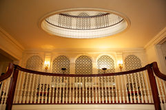 Grand staircase. Looking up at the staircase wooden balustrade and ornate wall panels royalty free stock image