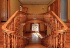 Grand Staircase. Staircase from second floor landing, looking at front entrance Royalty Free Stock Photo