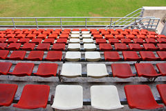 Grand stand, seat in stadium. Grand stand, orange and white seat in stadium. (in horizontal royalty free stock image